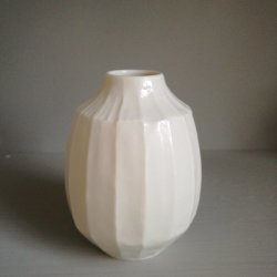 Small thrown and carved porcelain bottle