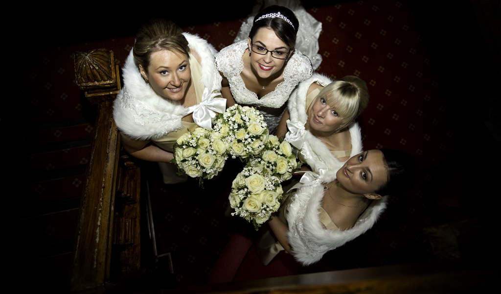 Bride and bridesmaids looking up