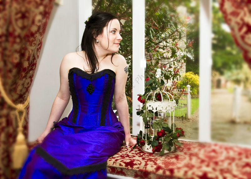 Victorian bride in the window seat Ruthin Castle in electric blue