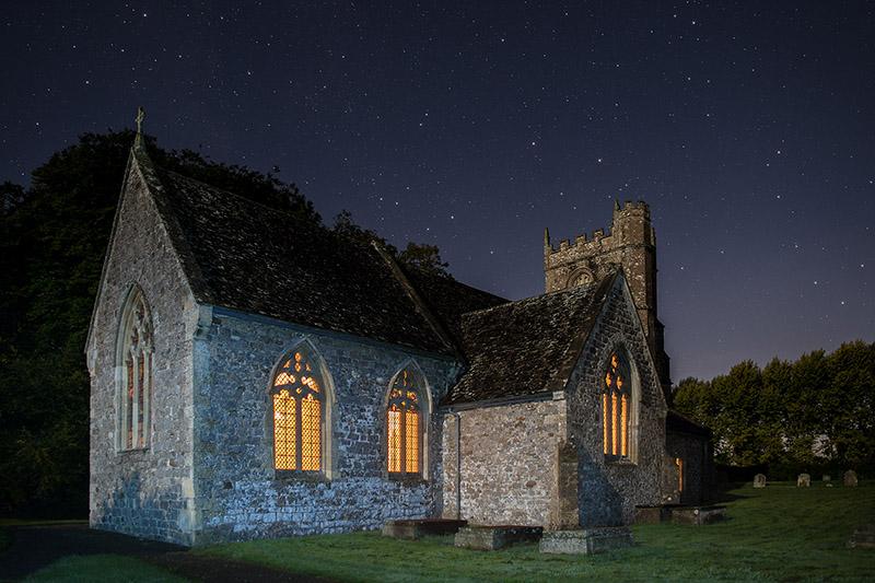 Winterbourne Bassett church by moonlight