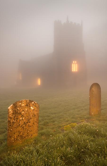 Winterbourne Bassett church in misty moonlight