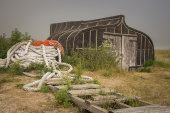 Upturned fishing boat shed
