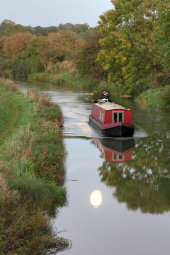 Canal boat at full moon