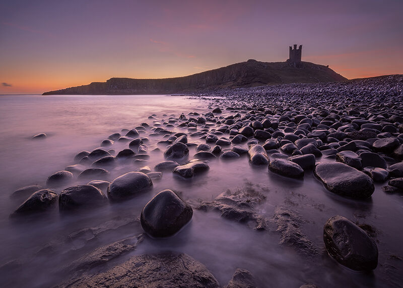 Dunstanburgh Castle at dawn