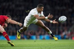 England's Anthony Watson fires a pass during the England v Wales RWC2015 fixture