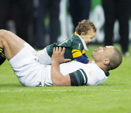 Bryan Habana with his son Timothy after the Scotland v South Africa RWC 2015 fixture