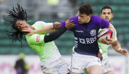Nick de Luca of Scotland hands off Branco du Preez of South Africa