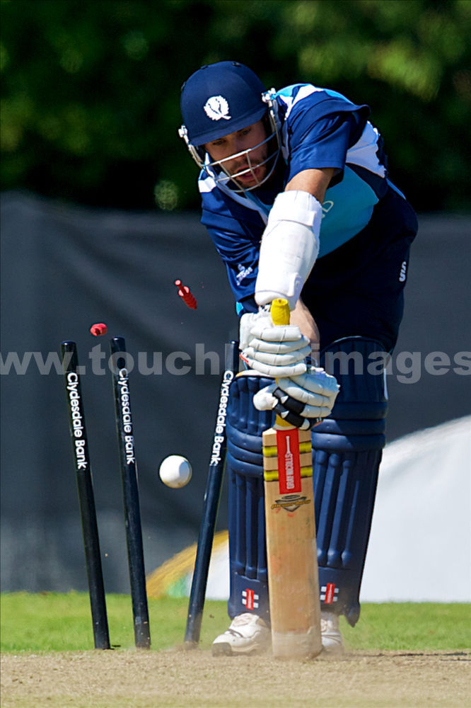 Scotland's Kyle Coetzer is bowled by Lasith Malinga
