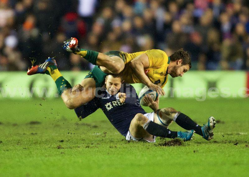 Greig Laidlaw of Scotland  topples Mike Harris of Australia