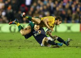 Greig Laidlaw of Scotland  topples Mike Harris of Australia