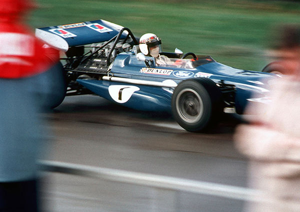 Jackie Stewart passes the Silverstone Pits in the Tyrell March