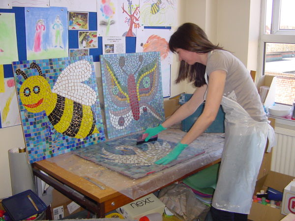 Sue Kershaw grouting children's school mosaics
