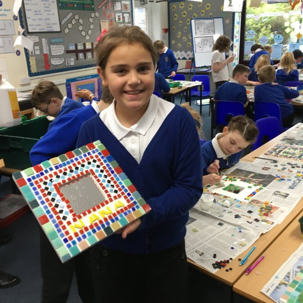 Sue Kershaw with children creating a mosaic