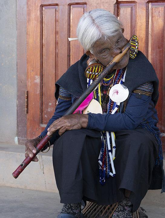 Nose Flute Player