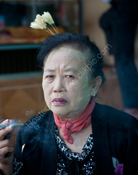Woman smoking a Cheroot