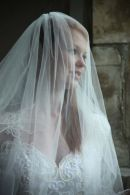 Bride standing in front of a window