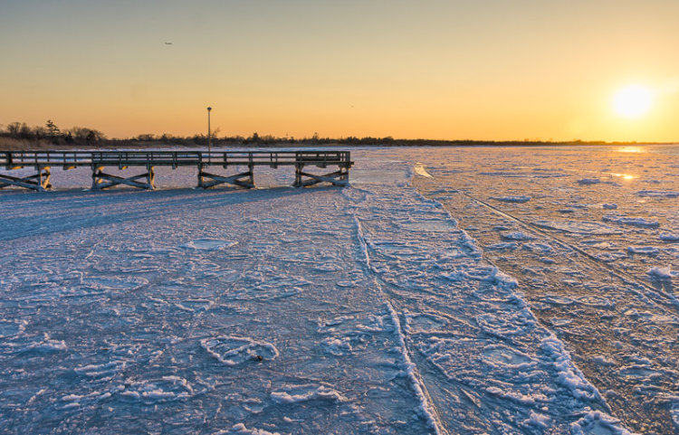 Sunset On Ice And Pier