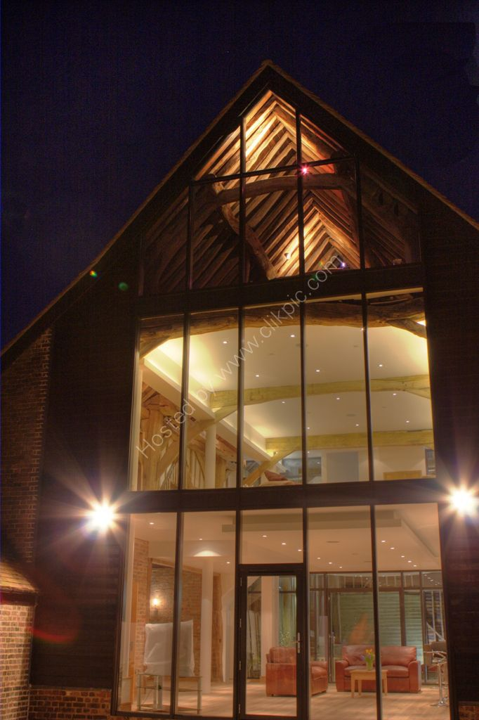Barn conversion, exterior viewed at night