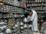 A trade in the souq over pots and pans