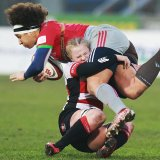 Gloucester- Hartpury Women V Harlequins Ladies at Kingsholm Stadium - Charlotte Faux makes a tackle