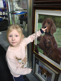 This is Bev and Gary's Granddaughter at Crufts with their painting .. ahh!