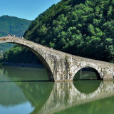 The slender grace of the Ponte della Maddalena, built in a.d. 1100, known as the Devil's Bridge, at Borgo a Mozzano