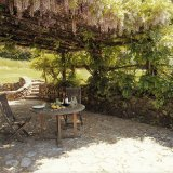 The Easthouse patio with shade from the wisteria pergola