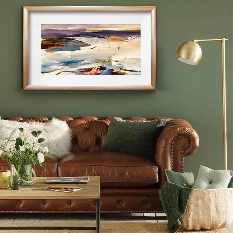 A room for relaxation, with framed abstract landscape