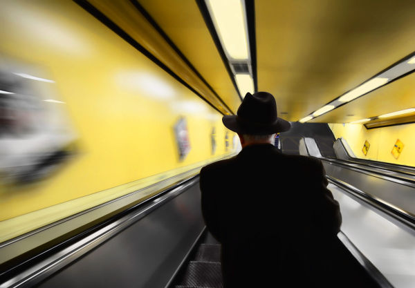 """Man in Black on Escalator"""