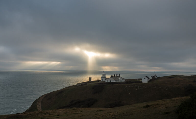 Sunbeams over Anvil Point lighthouse