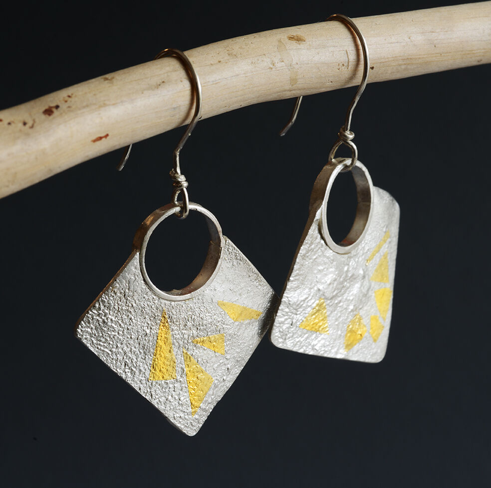 E18034 - Earrings: reticulated silver and 24kt gold highlights