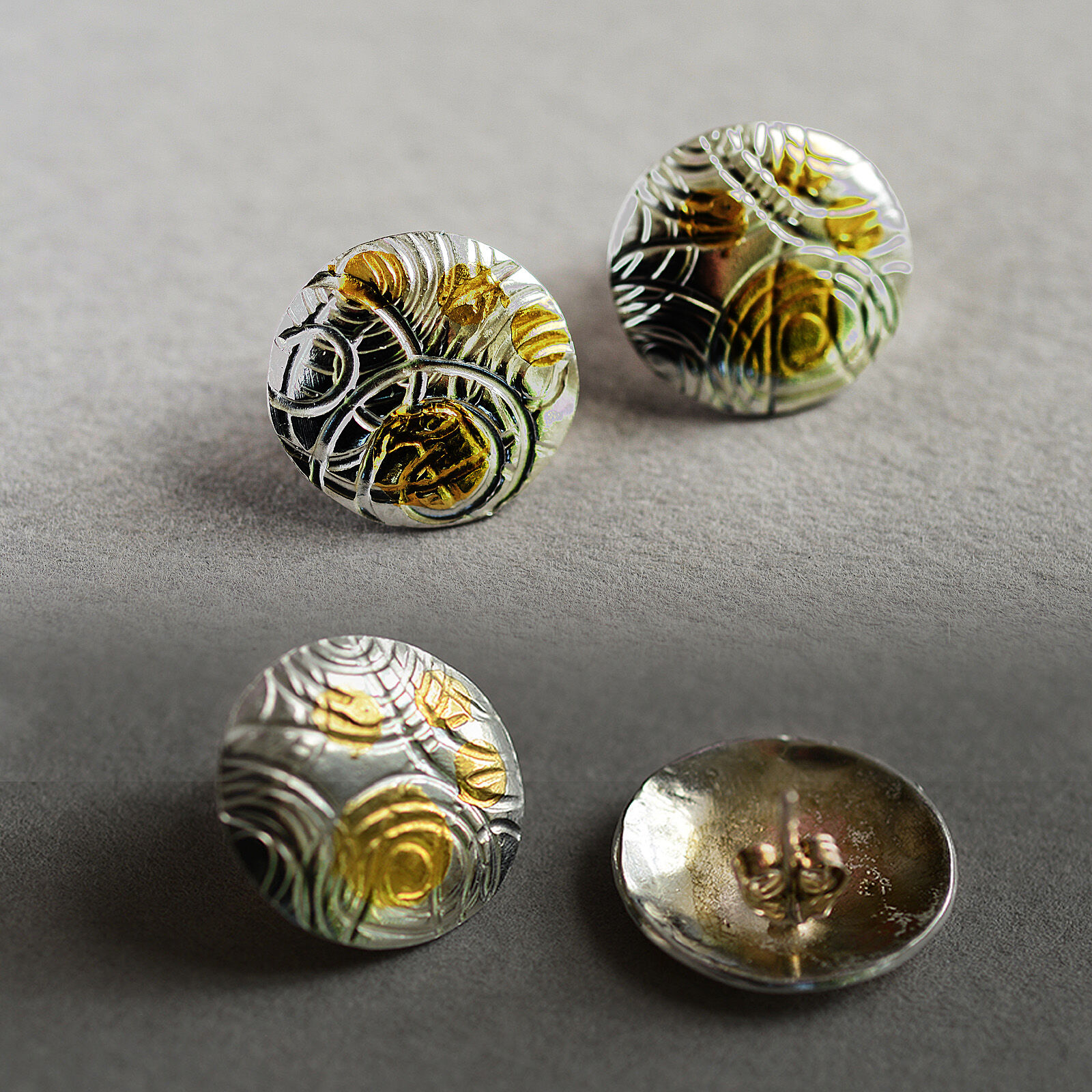 E20005 - Silver and gold domed and patterned earrngs