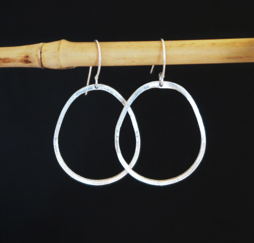 E20045: Pear shaped sterling silver hoops