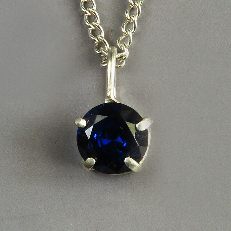 N18003 - Blue sapphire in hand-crafted sterling silver prong setting.