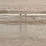 Humber bridge support reflected in mud