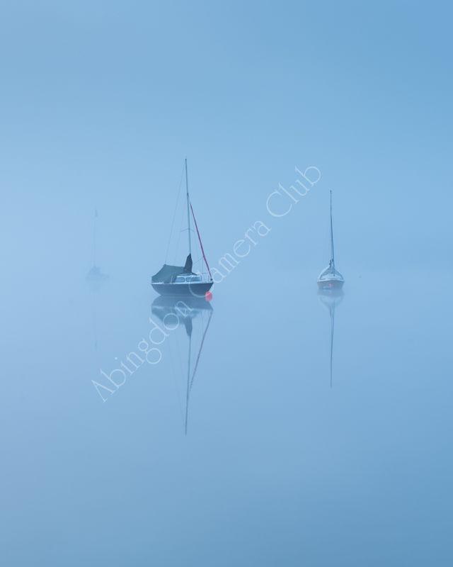 Boats on a misty morning