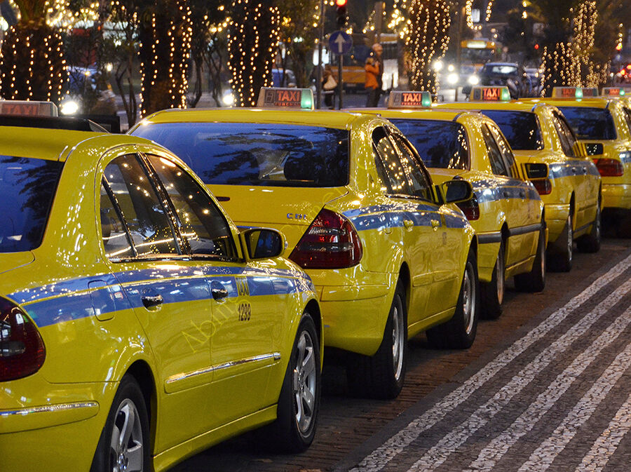 Taxis under festive lights