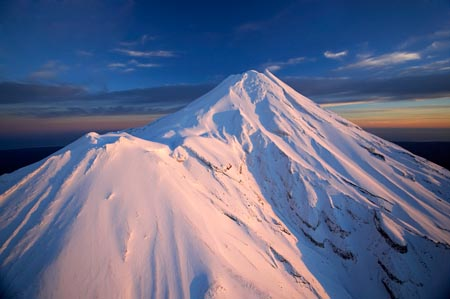 Alpenglow on Summit of Mt Taranaki / Mt Egmont at Dawn, Taranaki, North Island, New Zealand - aerial