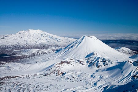 Mt Tongariro (far right), Mt Ngauruhoe (middle), and Mt Ruapehu (far left), Tongariro National Park, Central Plateau, North Island, New Zealand - aerial