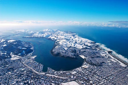 Dunedin and snow, South Island, New Zealand - aerial