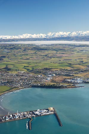 Port of Timaru, Caroline Bay, Timaru, and Snow on Southern Alps, South Canterbury, South Island, New Zealand - aerial