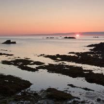 Sunset from Cobo Bay