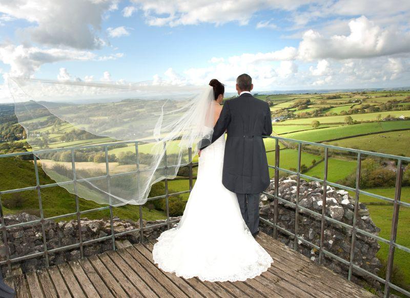 Bride and Groom enjoy the view at Carreg Cennen Castle, Llandeilo