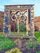 Stone window in the churchyard of St Peter's Church in Sandwich Kent