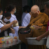 Monk collecting food donation