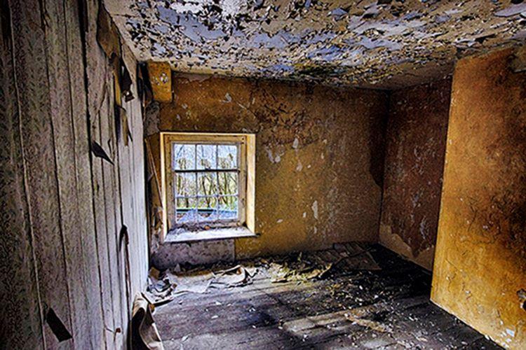 Room with peeling paintwork
