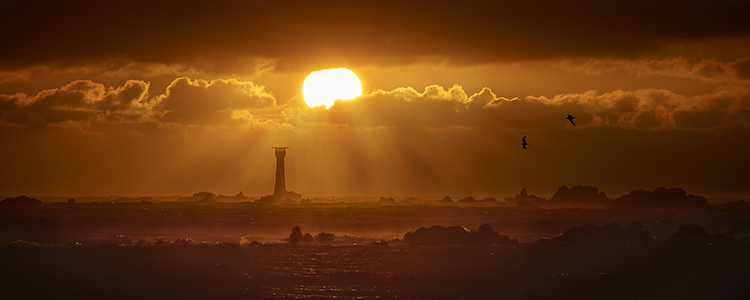 Sunset and light house
