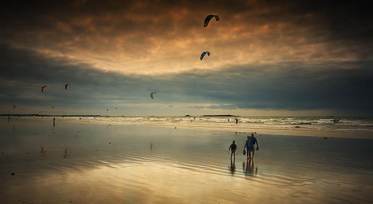 Kite surfing and beach scene