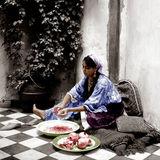Woman peeling Pomegranites