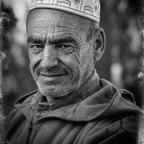 Man wearing a skull cap.